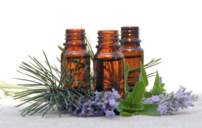 Three vials surrounded by natural ingredients.