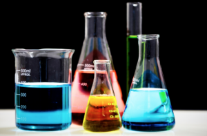 Beakers of colored liquids