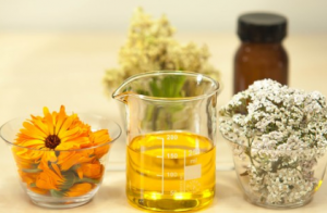 Flowers and oil in jars.