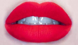 Close up of red lips.