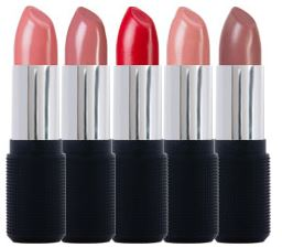 Lipsticks lined up with lids off.