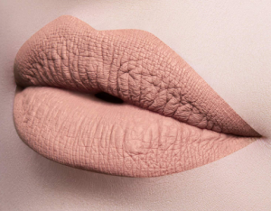 Lips with nude lipstick.