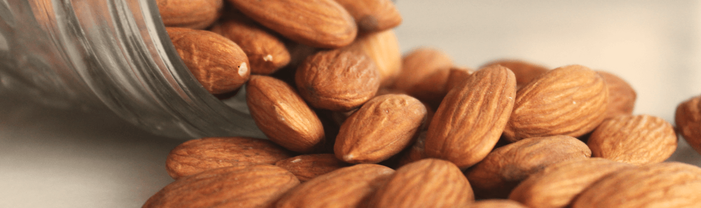 Almonds spilling out of bowl.