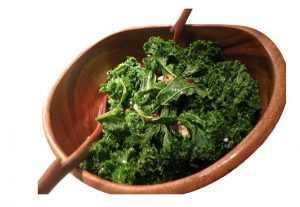 Wooden bowl with kale salad.