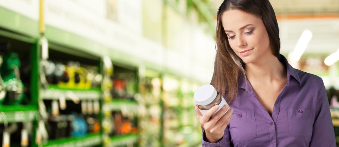 Woman checking label.
