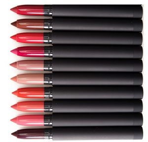 Lip crayons laid out in a row.