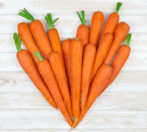 Carrots laid out in a heart.