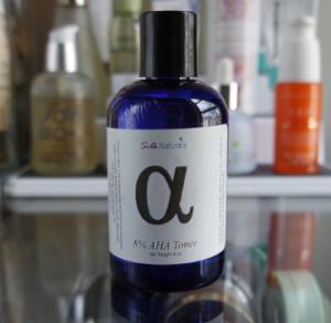A bottle of Silk Natural AHA toner.