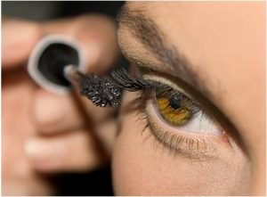 Close up of mascara being applied to eye.