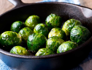 Brussels sprouts cooking in a pan.