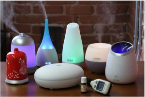 Assortment of oil diffusers on table.