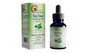Tea Tree Essential Oil bottle next to packaging.