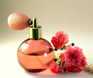 Perfume in a pink decorative bottle with pink flowers.