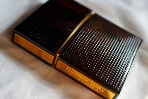 Black and gold perfume case.