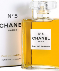 Chanel No. 5 perfume in a clear bottle next to box.