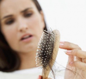 Woman picking hair out of comb.