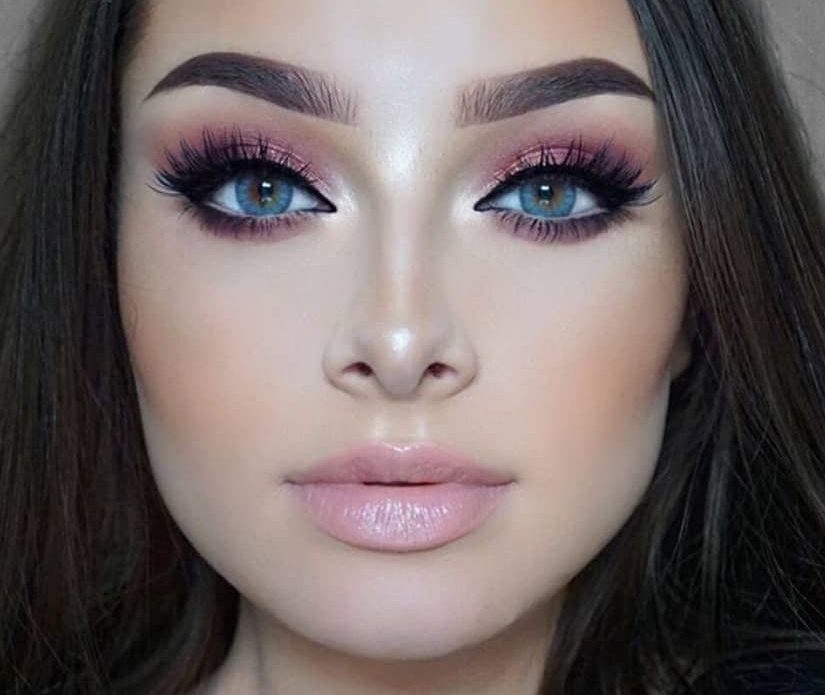 Woman with pink makeup.