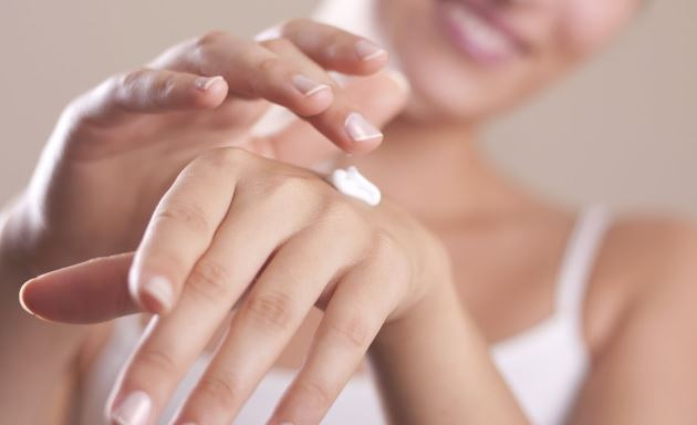 Applying lotion to hands.