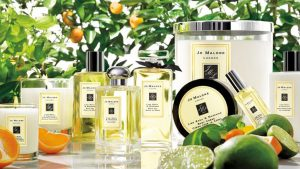 Assortment of Jo Malone products in front of orange tree.