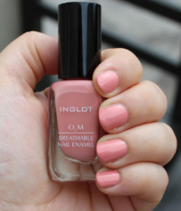 Hand holding nail polish.