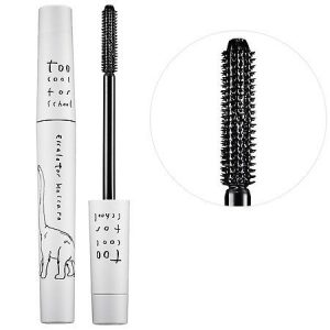 Open mascara packaging and wand close up.