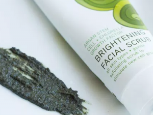 Close up of Acure Organics Brightening Facial Scrub next to swatch of green scrub.