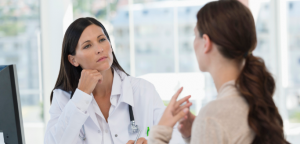 Woman speaking with a doctor.