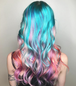 Brightly dyed curly hair.