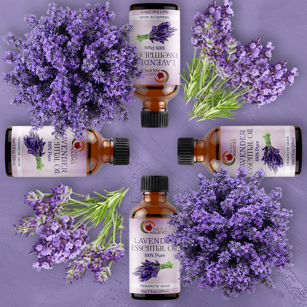 Lavender essential oil laid out in a cros with lavender flowers.