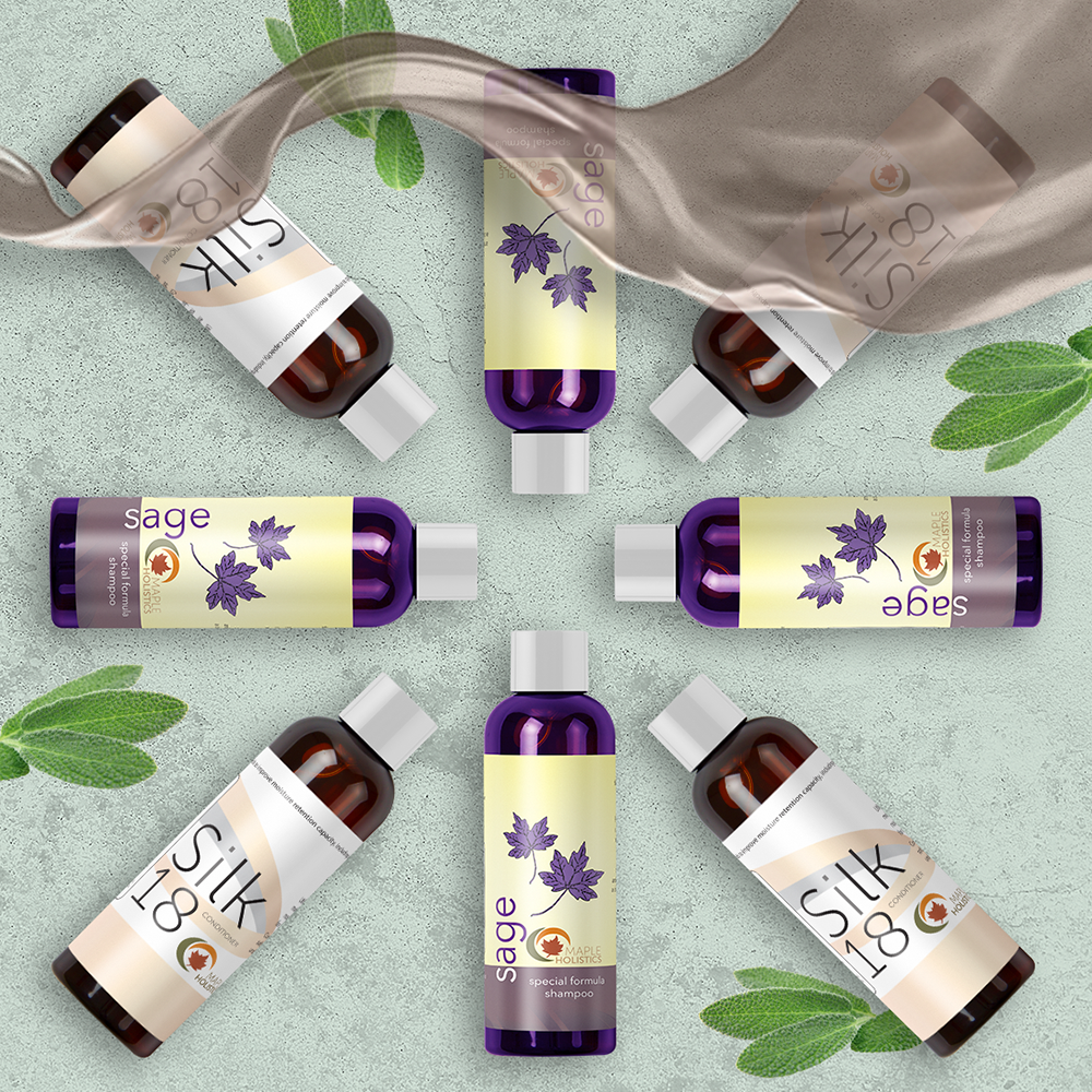 Bottles of sage shampoo and silk 18 conditioner laid out in a circle with leaves and blonde hair.