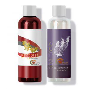 A bottle of Maple Holistics tea tree shampoo and argan conditioner to repair and restore hair strength.