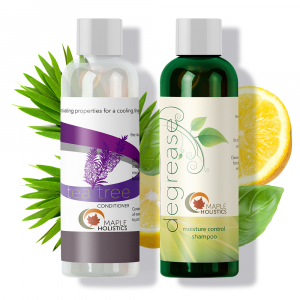 A bottle of Maple Holistics degrease shampoo and a bottle of tea tree conditioner.