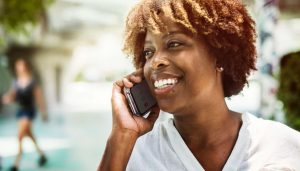Woman smiling while talking on cellphone.