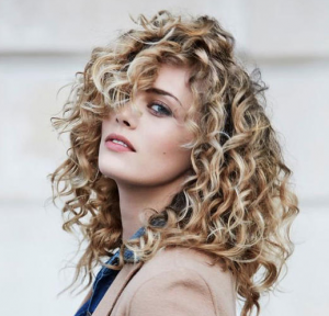 Woman with blonde, springy curls.