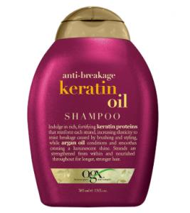 A bottle of OGX's anti-breakage keratin oil shampoo.