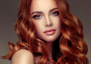 woman with red hair and makeup on