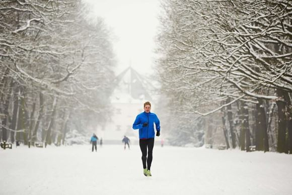 Man running in the snow.