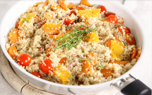 Quinoa in pan with fruits and vegetables.