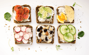 Assorted toasts with different toppings.