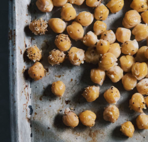 Chickpeas laying on a pan.