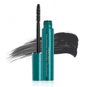 Open bottle of mascara with sample behind.