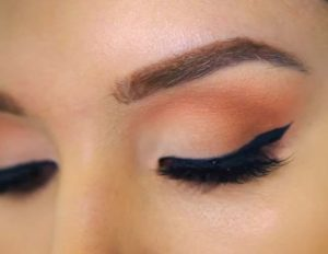 Close up on woman wearing eyshadow.