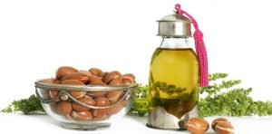 Argan nuts and a bottle of argan oil.