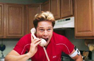 Brad pitt using phone during scene in burn after reading.