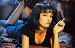 Uma thurman lying down and smoking in pulp fiction scene.