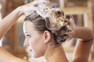 Blonde woman washing her hair.