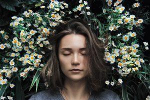 Girl lying in daisy's.