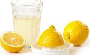Halved lemons and a cup of lemon juice.
