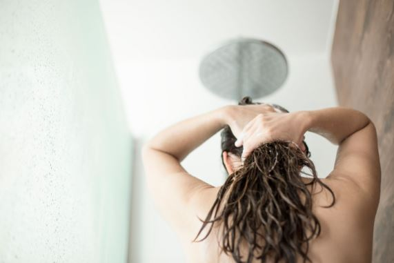 Woman washing her hair.