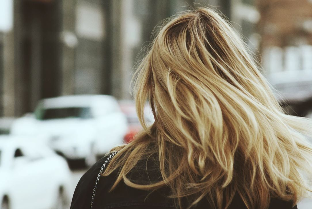 Blonde haired woman from behind.